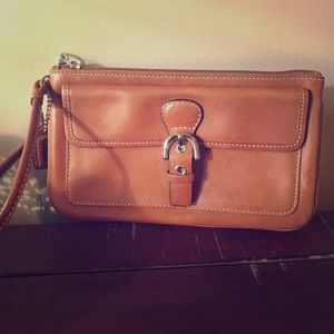 Coach tan leather wristlet with silver hardware